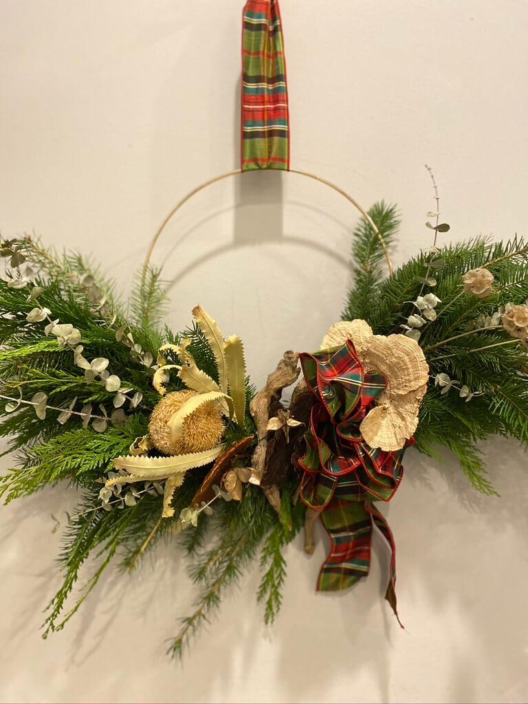 Fresh evergreen half moon hoop wreath with dried elements