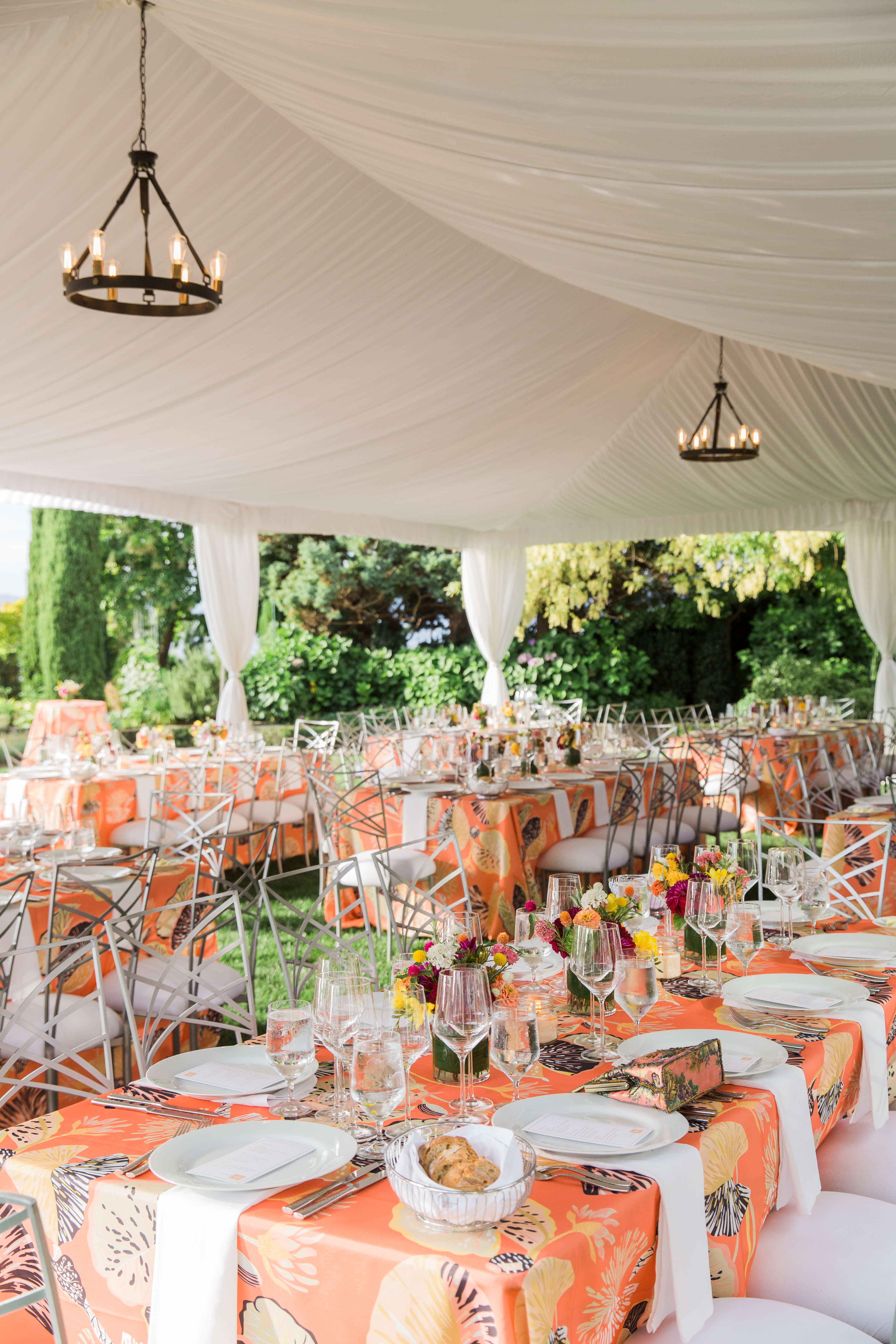 brightly colored table linens to match summer flowers